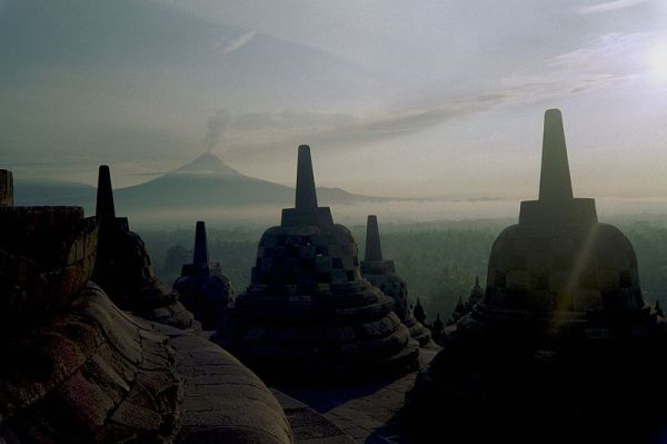 The Borobudur Buddhist Temple in Magelang, Central Java, Indonesia with Mount Merapi in the background. Image by ctsnow.